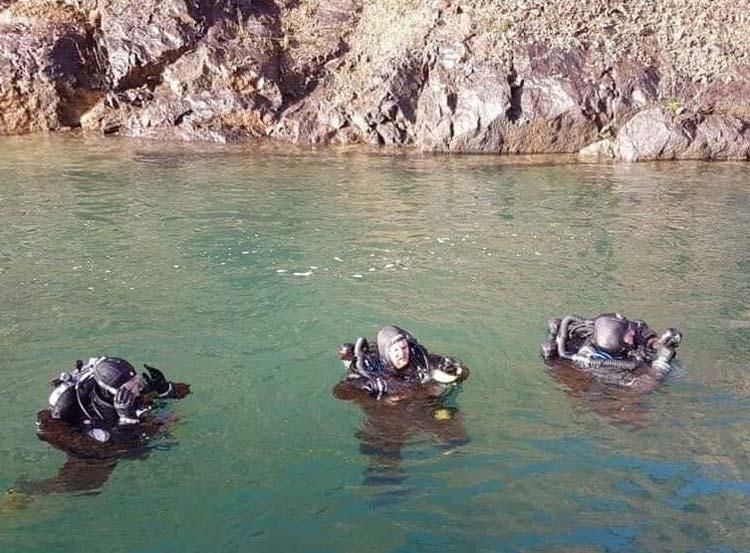 Scuba divers preparing to descend