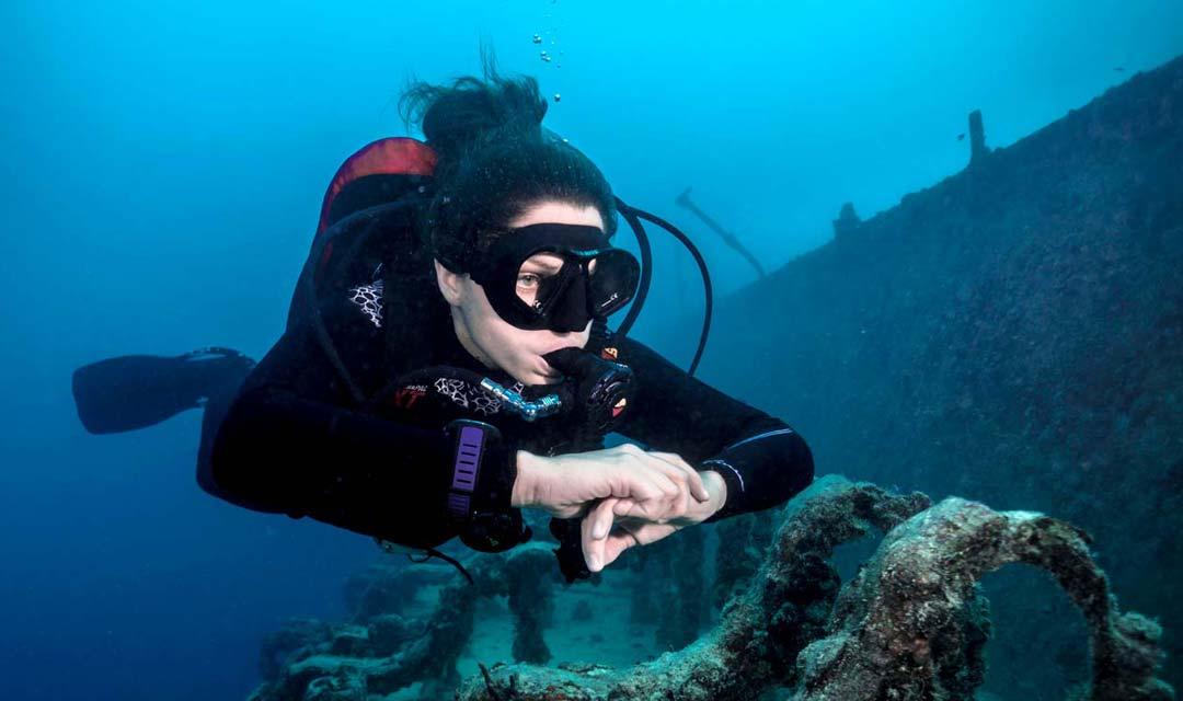 SDI-Diver-Exploring-Large-Wreck-Photo