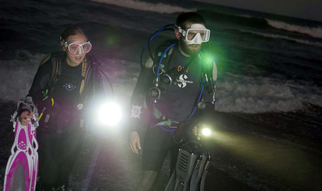 SDI-Divers-Coming-Out-of-Water-at-Night